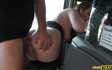 Busty doll tries anal on the back seat