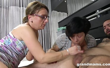 Nasty mature sluts battle over one younger dick together with want in all directions