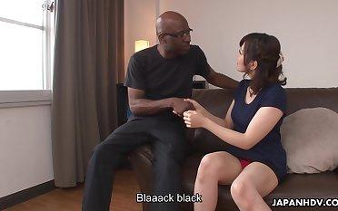 Japanese girl Tomoka Sakurai shows her dripping pussy to black man