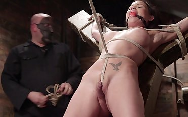 Raven Bay is expertly bound with rope and fucked with a edict dick