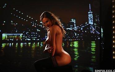 Crestfallen solo video of pornstar Tina Kay stripping and teasing