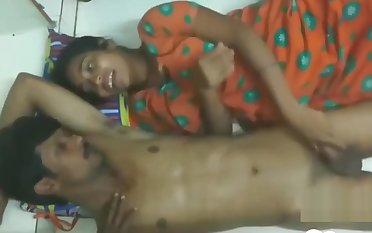 Indian couple having an amazing time on the floor gather up
