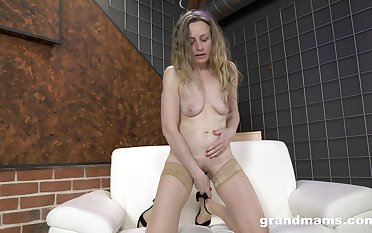 Mature blonde relating to nude stockings takes nurse b like of her own sexual needs