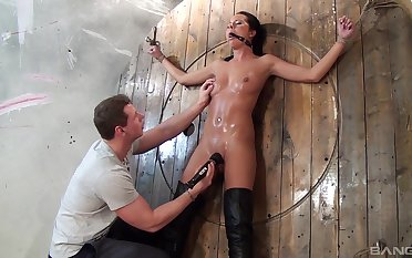 Nonchalant pussy poking with sex toys at near torture for Mia Manarote