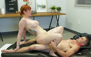 Red-haired MILF Lauren Phillips gives influentially exposed to a massage