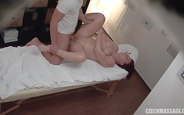 Gorgeous chubby redhead fucks her masseuse
