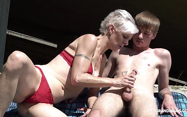 Kinky granny in cords sucks a big hard penis of several young guy