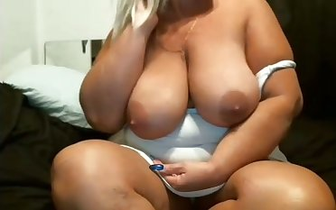 This mature floozy is hot and I'd love thither fire my cumshots all over her phat tits