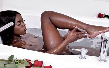 Ebony beauty precipitation her sensible pussy and clit